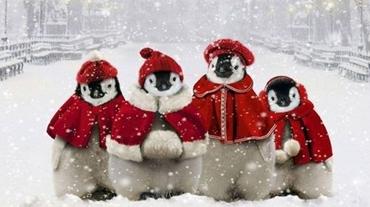 Julebillede med pingviner i nissedragter